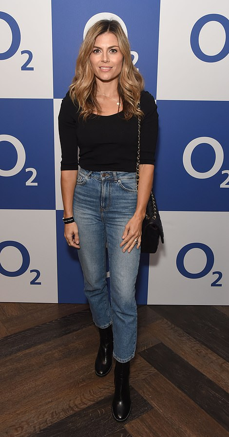 Autumn chic: Zoe showcased her chic sense of style in jeans and a milkmaid top