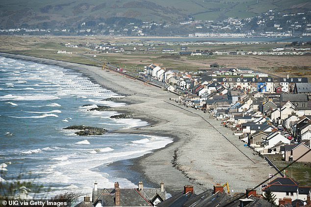 Mr Morris also took this image of new sea defences protecting houses in the low-lying seaside village of Borth, Ceredigion, in west Wales