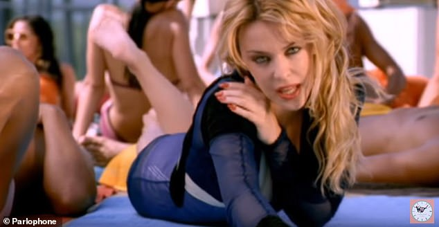 Remember this? She thrilled fans when she released the music video for her hit single Slow, back in 2003 (pictured)