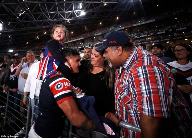 Latrell Mitchell celebrated with his family at a sold out ANZ Stadium after the Roosters' stunning victory