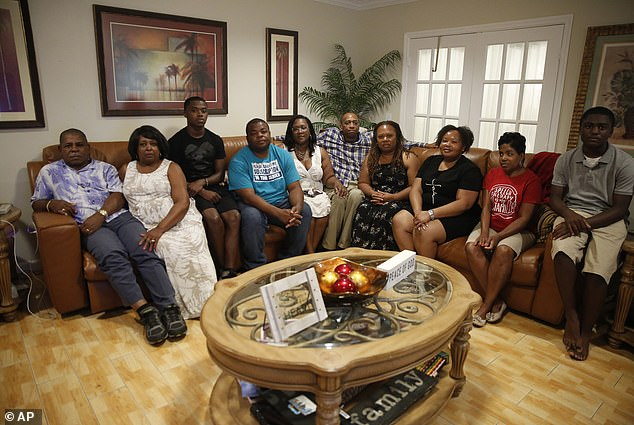 Somerville pictured in black third from left surrounded by his supportive family on Thursday October 3