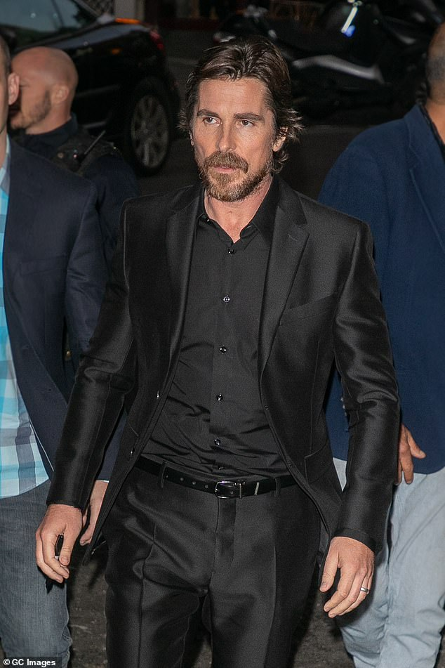 Dapper: Christian Bale, 45, opted for an all black ensemble for the Paris premiere of his new film Le Mans 66 on Sunday night