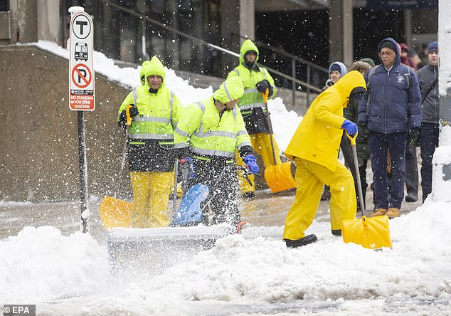 Above average snowfall from New York to Boston (pictured above during a March snowstorm) wouldn't hit until the start of the New Year, say the forecasters at AccuWeather