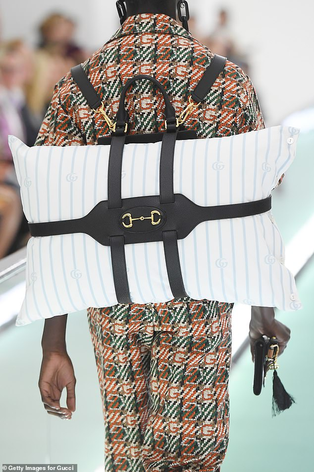 It comes amid a range of quirky and unusual designs for the famous label. In the same show they debuted models walking down the catwalk with a pillow strapped to their backs like a backpack