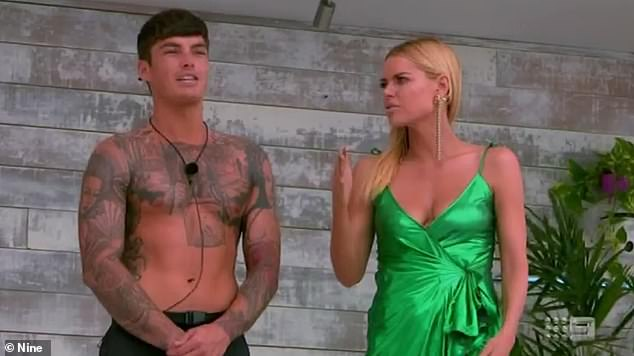 Alone:But poor Cynthia Taylu was left on the shelf when the incoming hunks failed to pick her, with Adam Farrugia skipping over her when there were just two girls left. Pictured:Adam Farrugia and host Sophie Monk