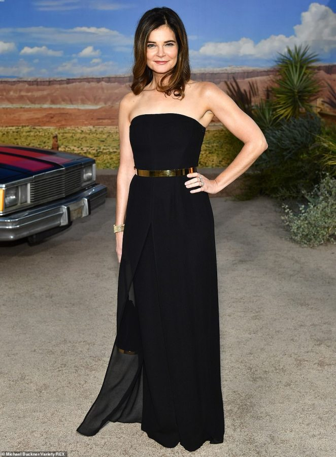 Strapless pantsuit: Betsy Brandt cut a sexy look in a black strapless jumpsuit, which featured sheer pants overlays