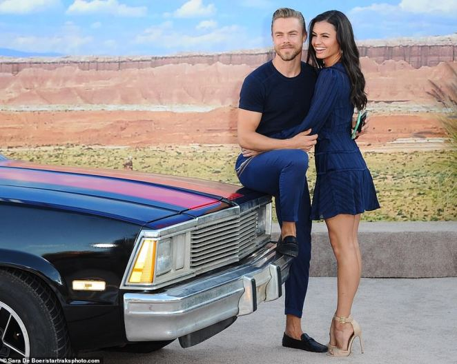 Ride-or-die: He was accompanied by girlfriend Hayley Erbert, who stunned in a blue velvet dress with ribbed stripes, paired with beige open-toe stilettos