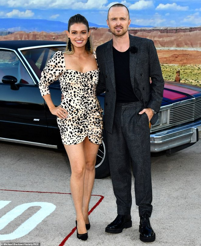 Long time coming: Aaron Paul was dressed to the nines Monday as he and wife Lauren Parsekian arrived at the Los Angeles premiere of El Camino: A Breaking Bad Movie