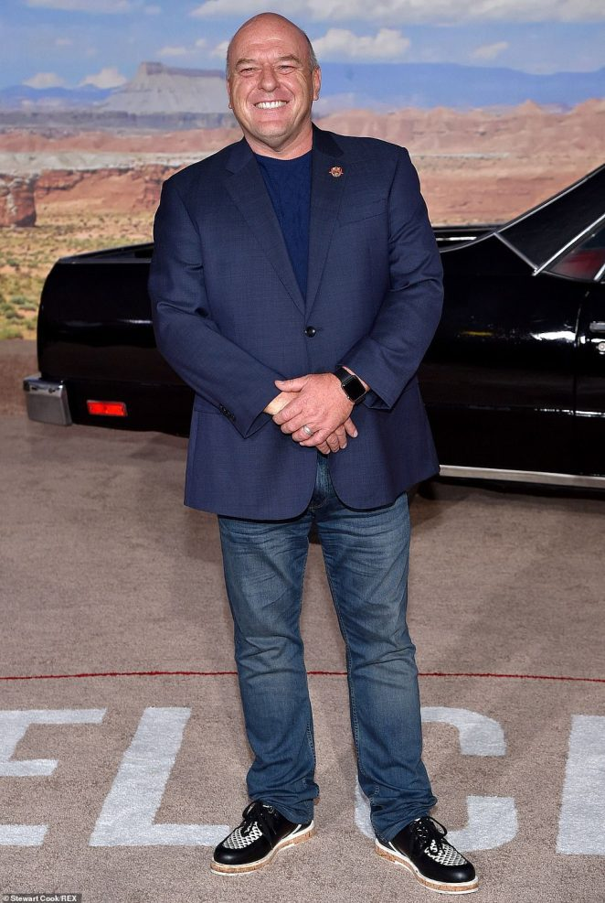 Denim chic: Dean Norris sported a blue blazer over a matching blue t-shirt with a pair of jeans and black-and-white loafers