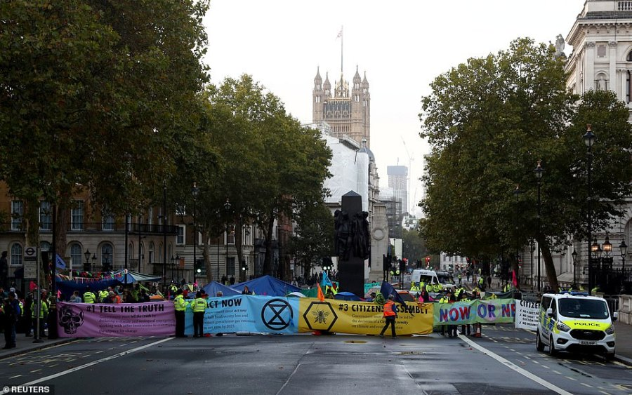 Extinction Rebellion protesters demonstrate at Whitehall as dawn breaks on day 2 of their two weeks of protests in London