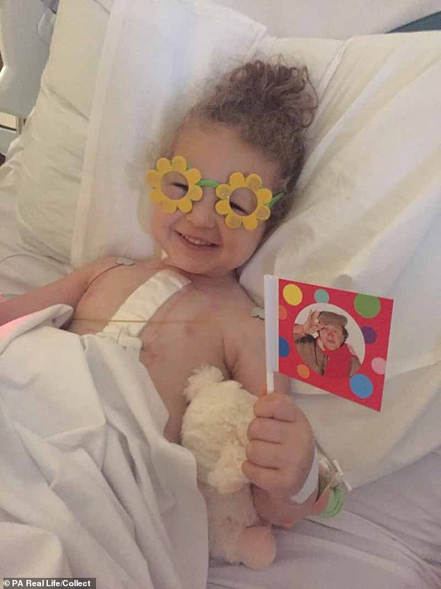 During the final quarter of 2018, Darcy's health took a turn for the worst and, while she was waiting for heart surgery, her parents took her to A&E five times in two months, complaining of stomach pains (Pictured in hospital)