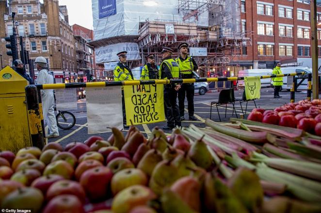 Morning breaks over Smithfield Market, one of London's busiest Meat suppliers, as an Extinction Rebellion offshoot Animal Rebellion wake up after a night occupying the space which is usually open from 2am to supply London's wholesale food industries