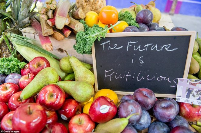 The future is fruitilicious: Meat traders at Smithfield arrived at work this morning unable to set up their stalls as they were covered in fruit and vegetables