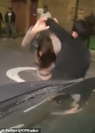Two women are seen fighting in the video