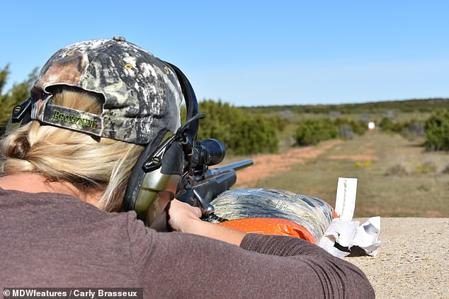 The mother-of-two at the shooting range. Carly said she was a conservationist, and said hunters helped conserve some animal species by never hunting them over their carrying possibilities