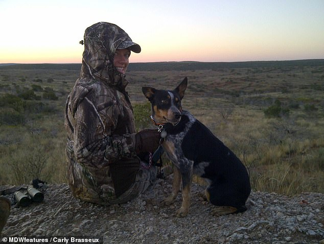 Carly, pictured with her dog on a hunt. The woman said she was actually helping wildlife by reducing the number of animal, thus avoiding overpopulation from one specific species