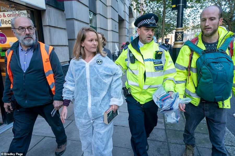 The first activist who glued herself to the DfT building brought a book but was not there very long before police arrested her