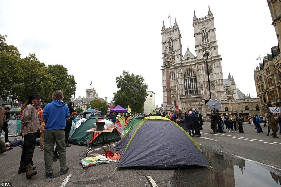 Tents remain in front of Westminster Abbey today despite threats that they will be thrown in a police van