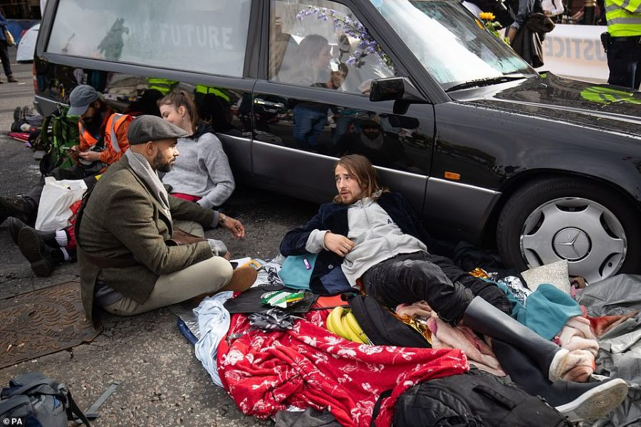 Protesters chained to a hearse during the Extinction Rebellion (XR) protest in Trafalgar Square