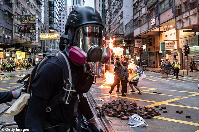 'Fight For Freedom. Stand With Hong Kong' is one of the slogans used by anti-government activists in Hong Kong. The city has been rocked by mass street protests for four months