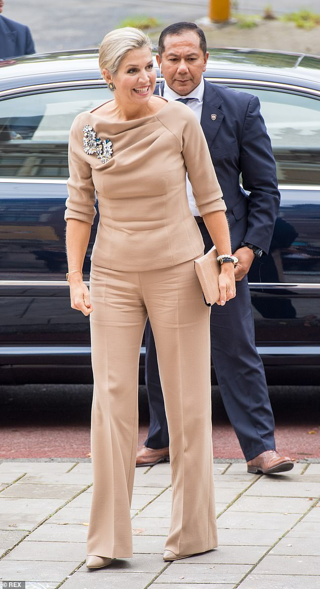 Queen Maxima of the Netherlands sported a beige boat neck top as she arrived for the Mental Health and Psychosocial Support conference in Amsterdam