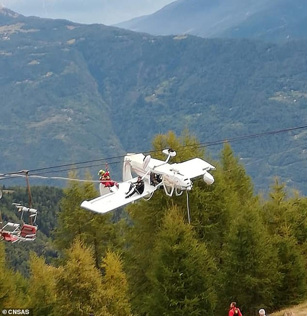 The light aircraft was seen ensnared in the ski lift overhead cables in theItalian resort of Lombardy following the crash today