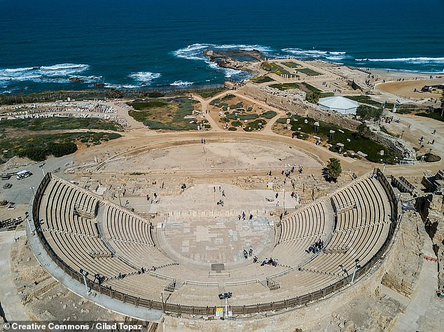 According to Professor Mastrocinque, the tablet's discovery in the ruins of such a prestigious theatre indicates that Manna 'must have been a famous artist.' Pictured, the ruins of Caesarea Maritima'stheatr