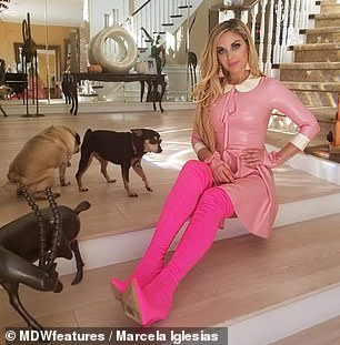 Barbie Dream House: The Argentina-born real estate investor pictured at home with her dogs in California