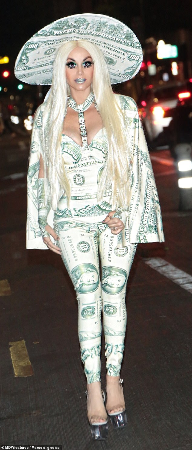 It's dollar Barbie! Marcela pictured at a recent party in Hollywood in a money-inspired outfit