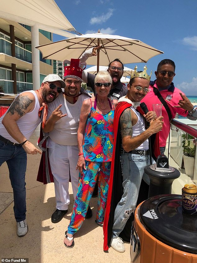 Heather Maskell, 63, from East Sussex, was on holiday in Cancun, Mexico, with her partner of 20 years Ray Lewry at the beginning of last month, where she goes every year (pictured centre with other holiday makers)