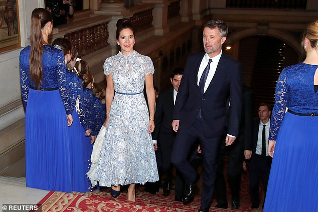 Crown Princess Mary of Denmark (centre left) looked every inch the belle of the ball as she arrived at Paris town hall on Tuesday evening, with husband Crown Prince Frederik, right