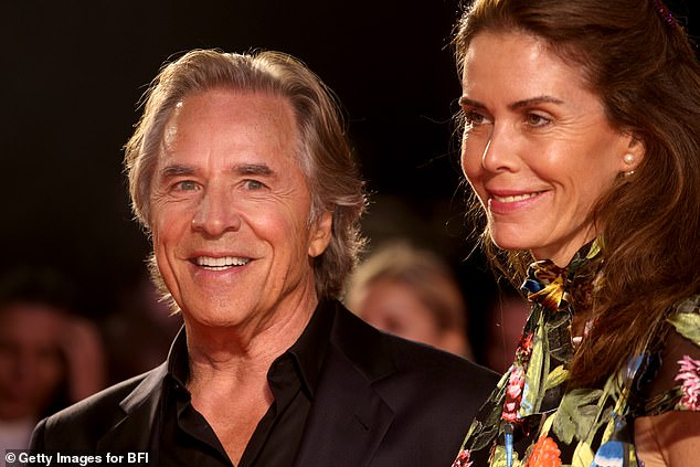 Happy: The Miami Vice star was glowing as he smiled for the cameras before the premiere