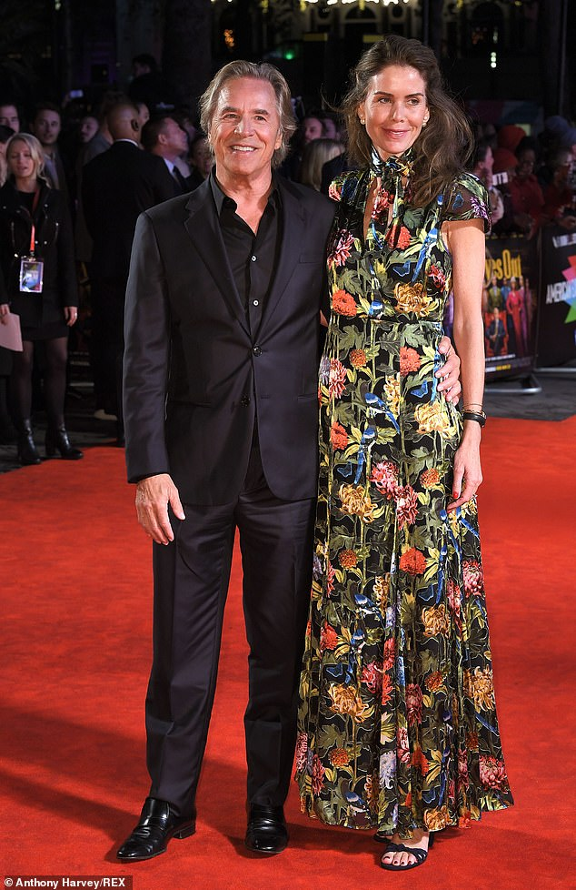 Perfect pair: Don and Kelley looked brilliant together on the red carpet in London's Leicestre Square with her bold dress standing out against his black suit