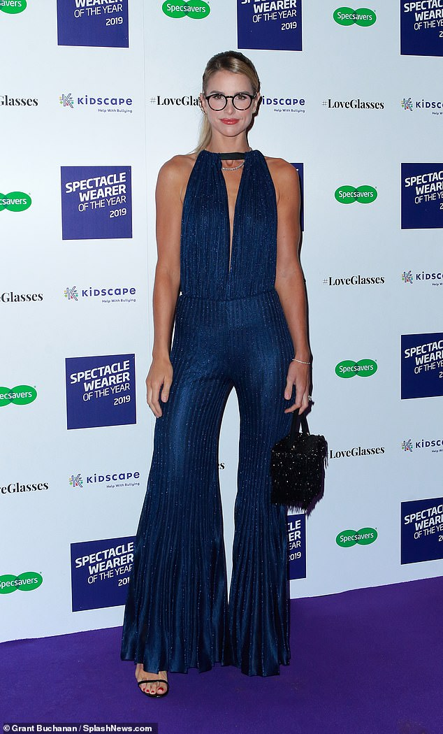 Beautiful in blue: Vogue looked incredible as ever, highlighting her lithe figure in a navy jumpsuit with wide-legged flares