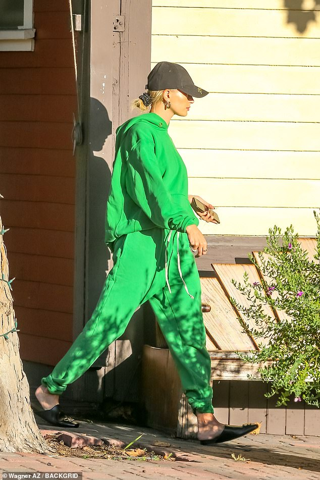Going green: Hailey appeared to be meeting with her husband while arriving at a recording studio in Los Angeles on Tuesday