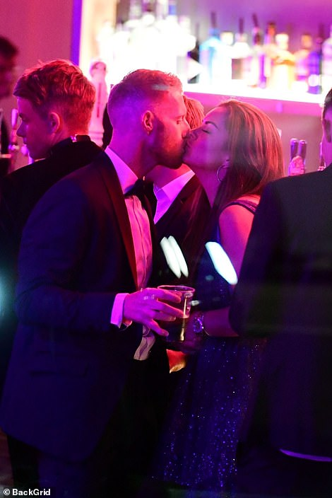 Ben and Clare got cosy in the bar, enjoying a hug and a kiss over a drink at the black tie bash a week ago