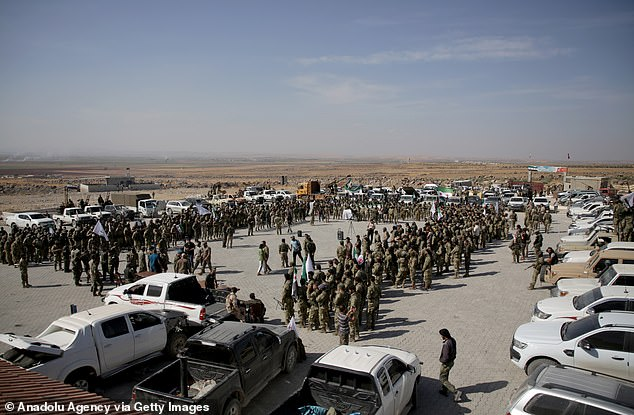 The SDF says all indication are that Turkey and its allies (including the Syrian National Army, pictured) are preparing for an attack against them