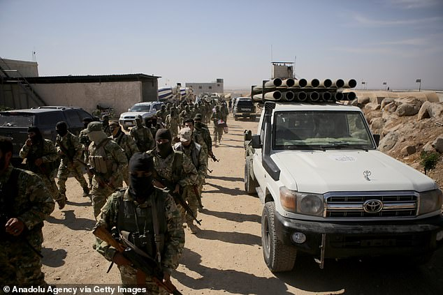 Syrian National Army forces - a rebel group allied with Turkey - assembles its forces near Aleppo on Tuesday in preparation for an attack