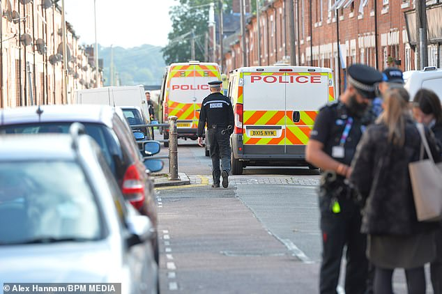 A mother-of-three has been stabbed to death in her home in Leicester (crime scene pictured) 'while her three children were still inside'