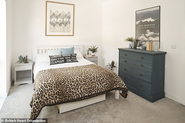 One bedroom was transformed by adding a headboard, new artwork and painting the cupboard dark blue