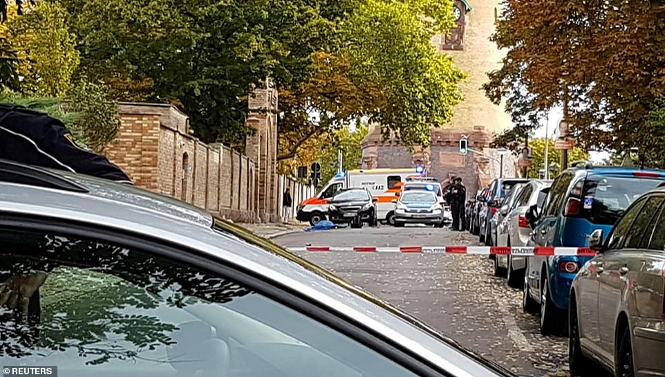 Armed police swarmed to the scene after the gunman opened fire. Witnesses said he used a submachine gun before throwing a grenade into a Jewish cemetery