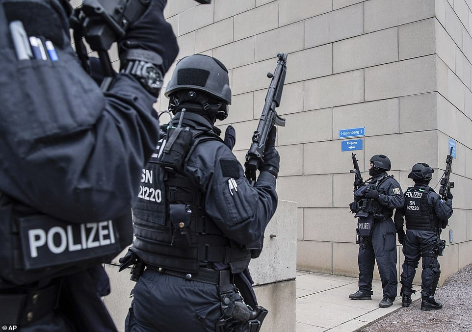 Police officers secure a synagogue in Dresden, Germany, following a shooting 90 miles away in Halle