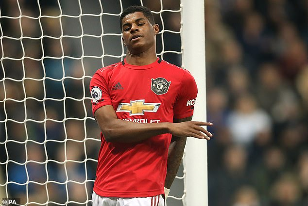 Marcus Rashford cuts a dejected figure during a poor performance at St James' Park
