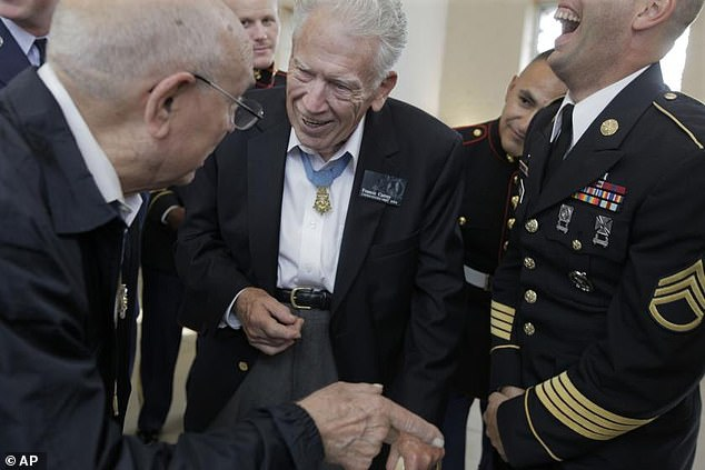 He was awarded the prestigious Medal of Honor for his valor in the Battle of the Bulge in Belgium on December 21, 1944 where he rescued American troops from German fire and stopped the Nazi advance into the Western Front. He was just 18 at the time. Currey pictured above in 2009 at a Medal of Honor convention in Chicago