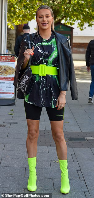 Wow factor: Demi turned heads in neon green boots and cycling shorts