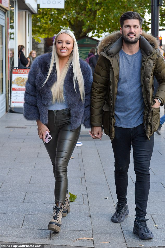 Over it: Amber and Dan's united appearance comes after she tearfully admitted she was ignored by him when he arrived at the same club as her on Sunday's TOWIE