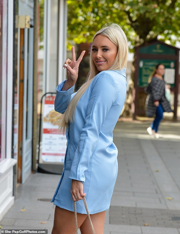 Peace: Amber added a boost to her height with diamante perspex heels and glammed up her look with a £1,280 blush pink Valentino bag