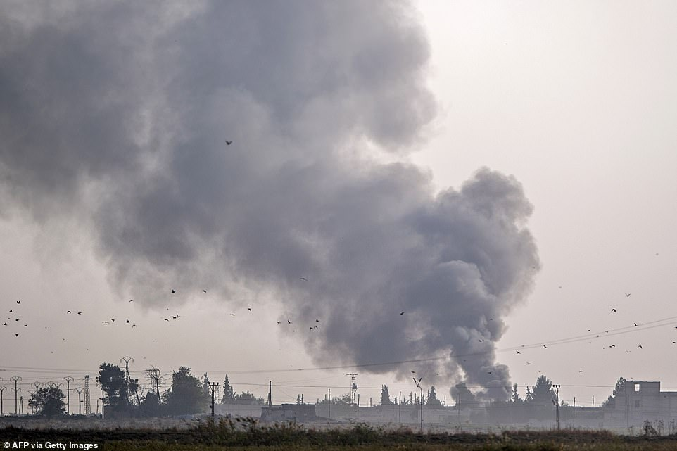 Thick smoke rises from the Syrian town of Tal Abyad after bombings by Turkish forces. President Erdogan is labelling the assault 'Operation Peace Spring'