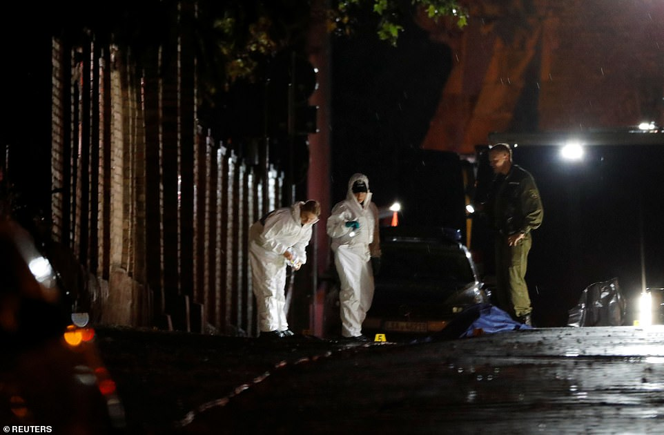 Forensic officers were working at the site where one of the victims was shot outside a synagogue on Wednesday