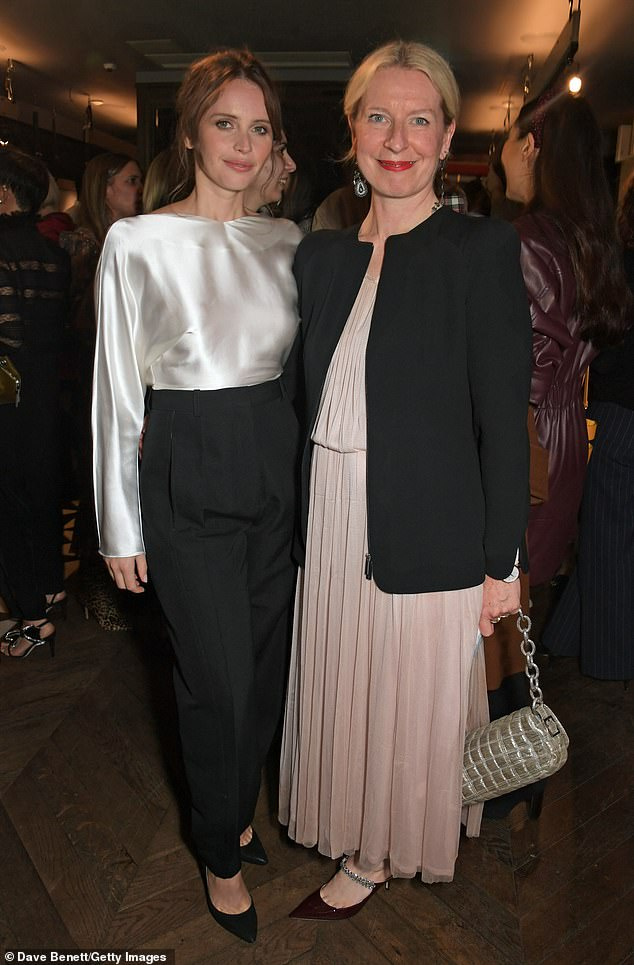 Looking good: The eye-catching top showed off her flair for fashion while the chic bottoms cinched in her tiny waist - posing withSarah Bailey